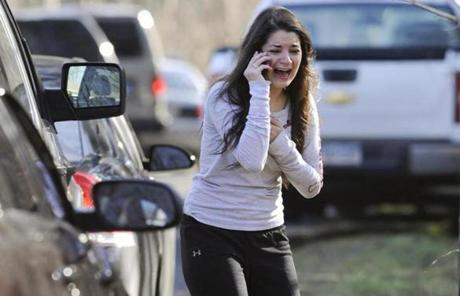 A woman waited to hear about her sister, a teacher, following a shooting at the Sandy Hook Elementary school.