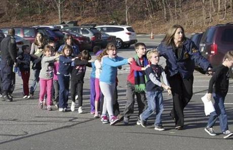 Connecticut State Police led children from the school shortly after the shooting.