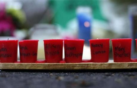 Candles displaying the names of shooting victims sat at a memorial in Newtown.