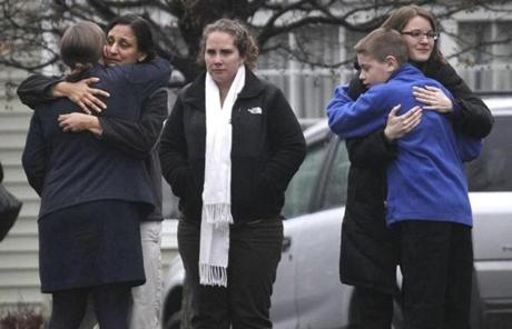 Mourners hugged outside of Honan Funeral Home on Newtown, Conn., during the funeral for six-year-old Jack Pinto.
