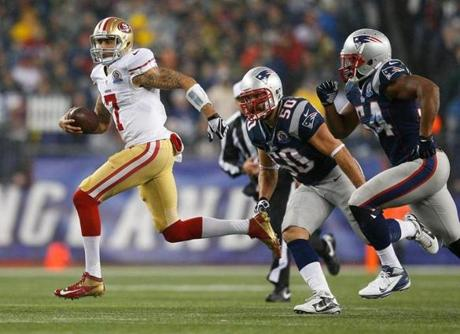 49ers quarterback Colin Kaepernick ran the ball in the second quarter.