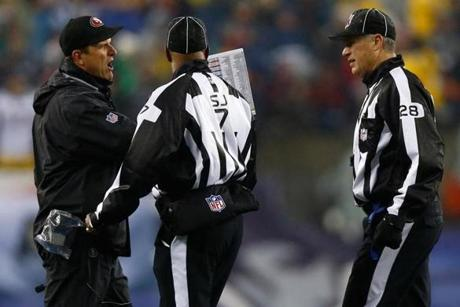 49ers coach Jim Harbaugh argued with side judge Keith Washington and head linesman Mark Hittner.