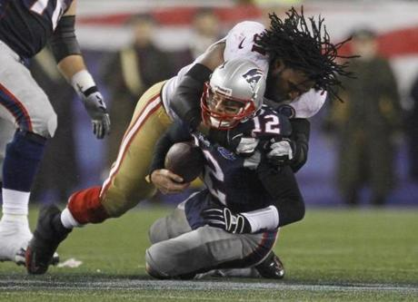 A helmet-less Ray McDonald sacked Tom Brady during the second half.