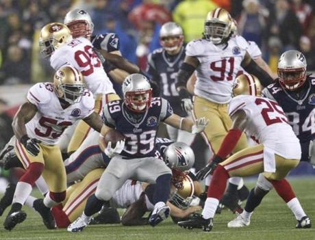 Danny Woodhead ran in between the 49ers' NaVarro Bowman and Tarell Brown during second quarter.