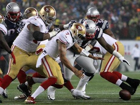 49ersquarterback Colin Kaepernick beat Patriots lineman Justin Francis to the ball as he recovered his own first quarter fumble.