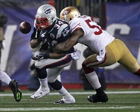 Patriots running back Shane Vereen fumbled as he was hit by the 49ers' NaVorro Bowman. The ball was recovered by San Francisco.
