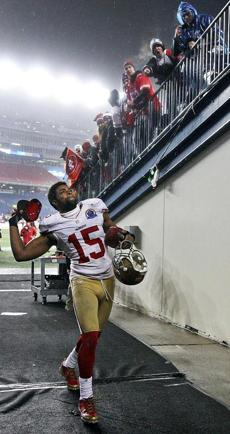 Michael Crabtree tossed his hat to some San Francisco fans as he left the field following the victory.