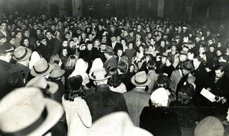 December 25, 1945:  Carolers in Louisburg Square sang of