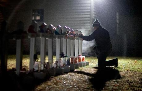 Frank Kulick adjusted a display representing the victims on his front lawn in Newtown.