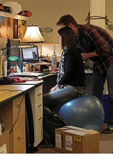 Kate Shane Middleton an event marketing associate at Vibram used an exercise ball instead of a chair as she worked at a desk.