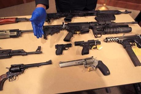 Boston police displayed some of the guns seized this year.