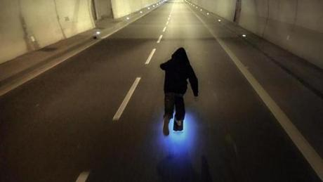 "The skateboard in the ""Firefly"" video is ringed with blue LED lights, and traverses an unnamed city."