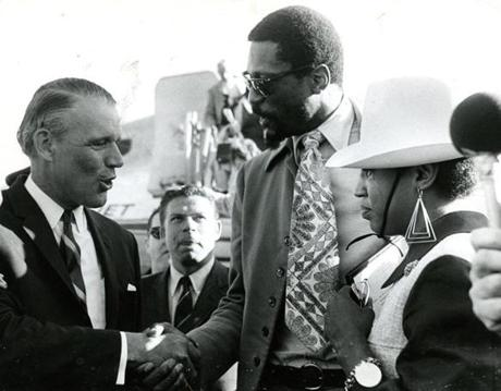 May 6, 1969: Bill Russell and and his wife, Rose Russell were greeted at Logan Airport by Governor Francis Sargent as they return home after the Boston Celtics won their 11th World Championship title. They defeated the Los Angeles Lakers 108-106 in a seventh-game win. The total playoff earnings for the team was $93,000. When asked what he would do with the cash, Russell replied,