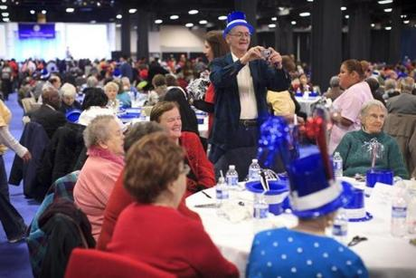 Vinnie McDonough of Dorchester took photos of his friends among the crowd of 2,300 seniors at the New Year's party.