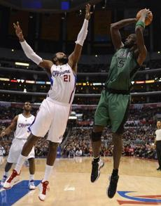 Kevin Garnett shot over Ronny Turiaf of the Los Angeles Clippers.