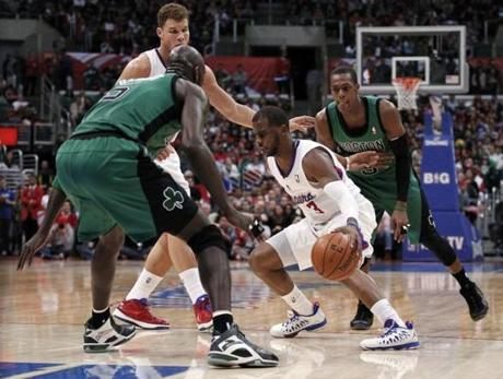 The Clippers' Chris Paul weaved between Kevin Garnett and Rajon Rondo in front of teammate Blake Griffin.