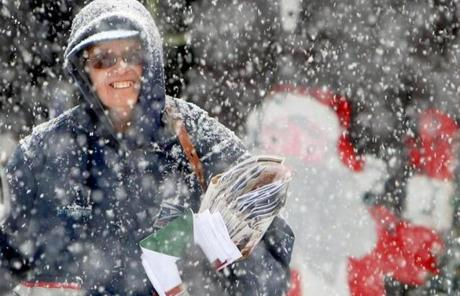 The storm dumped five inches of snow or more on parts of  Pa. That didn't deter this US Postal Service employee.