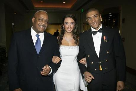 HAVING A BALL: Harold White and Midshipman 4th class Marquis White of Easton flank Brianna Sheehan of Raynham at the New England All Service Academy Holly Ball held at the Seaport Boston Hotel on December 29.
