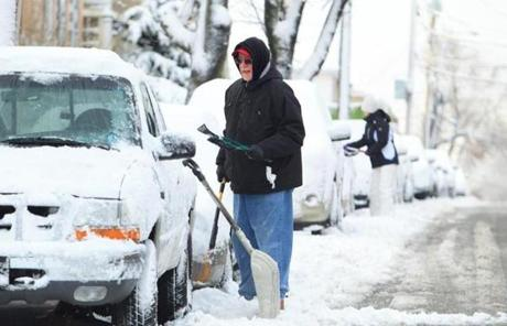 George Hudgins, and his niece Cassie Marsden, both of Meford, dug out their cars on North Street in Medford.