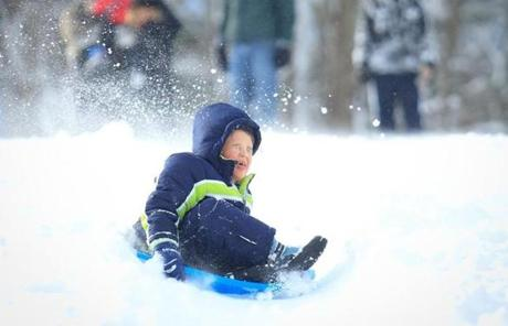 Braden Stephens, 6, of Denham Springs, Louisiana reveled in a morning of sledding in Hopedale, Mass.