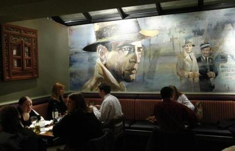 "Now there will no more sipping martinis under the watchful gaze of Bogey, painted on the wall facing the bar. No more whispering, ""We'll always have Paris."
