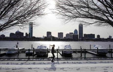 A woman jogged along the Charles River in Cambridge.