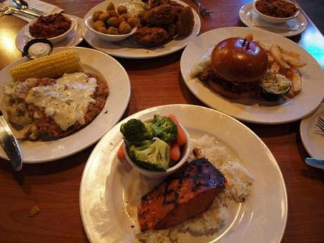 Clockwise from left: chicken fried steak, fried chicken, pulled pork sandwich, sweet bourbon salmon.