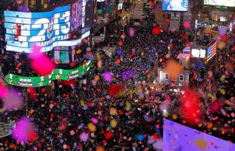 Confetti rained on revelers at midnight in Times Square in New York.