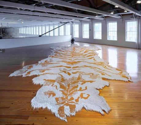 "Xu's ""1st Class,"" a faux tiger-skin carpet made from more than a half million cigarettes."