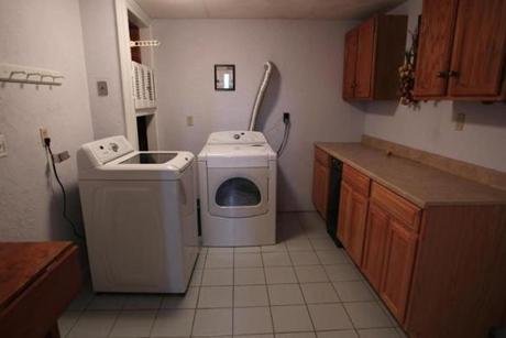 The ground level has a large laundry room.