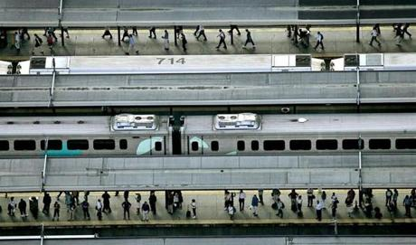 Boston, Ma., 7/17/06: South Station commuter rail rush hour in the afternoon, maybe more use because of the Big Dig accident. The MBTA said passenger numbers were up on all modes of transit Monday in light of the predicted traffic jams. ( David L Ryan/Globe staff photo )