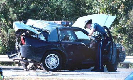 The cruiser of Trooper Ellen Englehardt was examined by a trooper on Route 25 in Wareham in 2003.