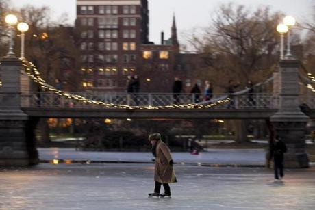 Boston, MA - 1/6/2013 - Edwin Geissler (cq) of Boston ice skates on the frozen pond in the Public Garden in Boston, MA on Sunday, January 6, 2013. (Yoon S. Byun/Globe Staff) Slug: n/a Reporter: n/a LOID: 5.0.1725229525