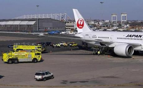 Massport Fire Department crews and equipment surrounded the Japan Airlines Boeing 787 Dreamliner after its arrival at Logan Airport.