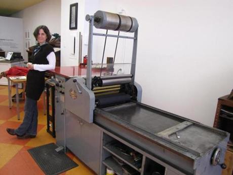 Melanie Mowinski stood near the fully automated Vandercook press, at PRESS.