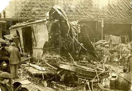 January 20, 1919:  A big section of the molasses tank smashed into the walls of the freight house of the Bay State Street Railway Co. with enough force to tear the structure apart.