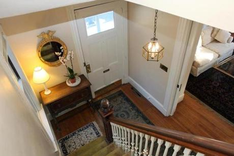 The front door opens to a foyer and elegant staircase.