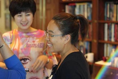 A Trademark Tours guest from Beijing (left) was assisted by a Harvard student serving as a Mandarin translator in July.