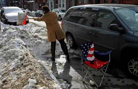 When it snows in Boston, residents use a variety of household objects to save parking spaces they have shoveled.
