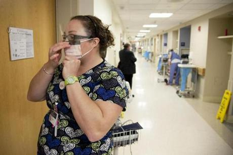 Emily Evans, a nurse at Beth Israel Deaconess Hospital, donned a mask as a precaution against the flu Wednesday.