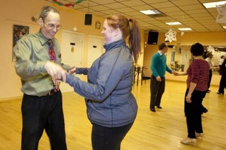 Students Carl Formichelli of Sharon and Colleen Cronin of New Bedford work out a swing dance lesson at Savaria.