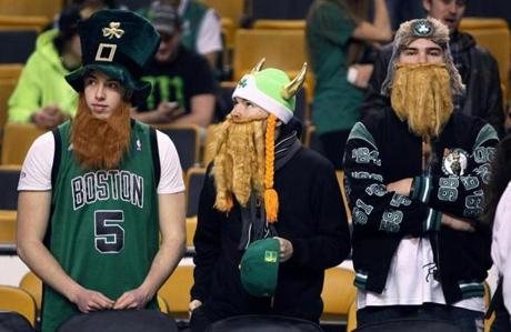 1/9/13: Boston, MA: Three fans in interesting get ups are pictured before the game. The Boston Celtics hosted the Phoenix Suns in a regular season NBA game t the TD Garden. section: sports topic: Suns-Celtics (Jim Davis/Globe Staff)