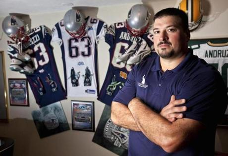 Joe Andruzzi at his Mansfield home with his NewEngland Patriots and Super Bowl memorabilia. He was a Patriot for five years — and three Super Bowl wins.