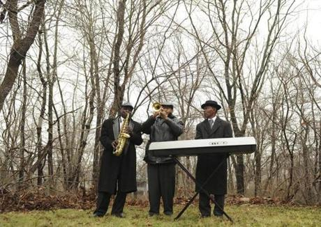 Saxophonist Schiller Joseph, trumpeter E. Daile Beauplant,  and organist Jean Louis Daniel  played during a service at the New Calvary Cemetery in Mattapan marking the third anniversary of the deadly 2010 Haiti earthquake.