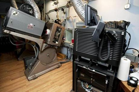 The projector on the right at Somerville Theatre is digital, the one on the left is film. It is expected that within 18 months, newmovies will cease to be released on celluloid.