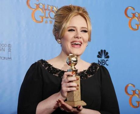 British singer-songwriter Adele held her Golden Globe award for Best Original Song for a Motion Picture for the James Bond movie