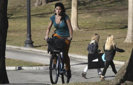 Jacinta Jimenez rode her bike in Boston Common on Monday as unseasonably warm weather hit Boston.