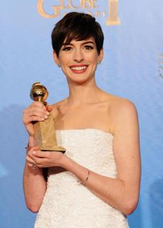 "Anne Hathaway, winner of best supporting actress in a film for ""Les Miserables."""