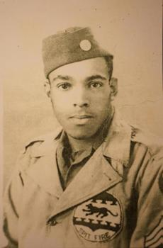 Eugene Jackson, 89, was a mechanic with the Tuskegee Airmen. This circa 1945 photograph of him at age 19 was taken in Ramittelli, Italy.