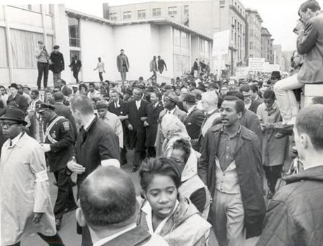 April 23, 1965: The Rev. Martin Luther King Jr. was at the center of the mile-long column of marchers walking from Roxbury to Boston Common. The march left the Carter Playground in Roxbury and ended at the Parkman Bandstand on the Boston Common. King spoke for about 25 minutes in a chilling drizzle to the crowd estimated at 22,000.